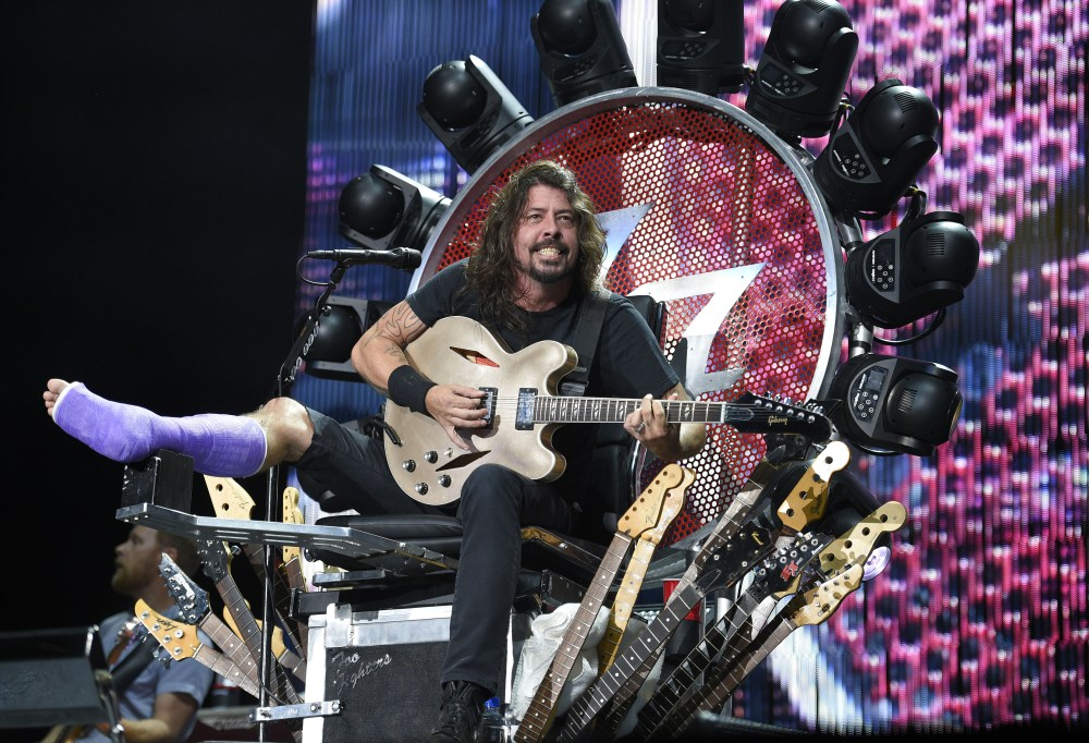 The Foo Fighters' Dave Grohl performs at RFK Stadium on Saturday, July 4, 2015, in Washington. (Photo by Nick Wass/Invision/AP) ORG XMIT: DCNW114